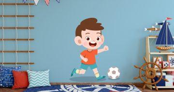 Αυτοκόλλητα Τοίχου - Χαρούμενο παιδάκι που παίζει ποδόσφαιρο