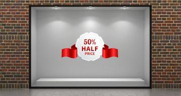 Αυτοκόλλητα καταστημάτων - Λευκό αυτοκόλλητο εκπτώσεων μισή τιμή με κόκκινη κορδέλα